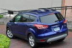 Picture of a 2014 Ford Escape SE in Deep Impact Blue from a rear left three-quarter perspective