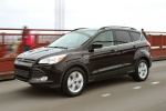 Picture of a driving 2014 Ford Escape in Tuxedo Black from a front left three-quarter perspective