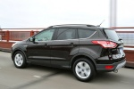 Picture of a driving 2014 Ford Escape in Tuxedo Black from a rear left three-quarter perspective