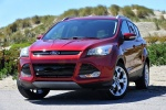 Picture of a 2014 Ford Escape Titanium 4WD in Ruby Red Tinted Clearcoat from a front left perspective