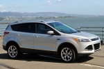 Picture of a 2014 Ford Escape Titanium 4WD in Ingot Silver Metallic from a front right three-quarter perspective