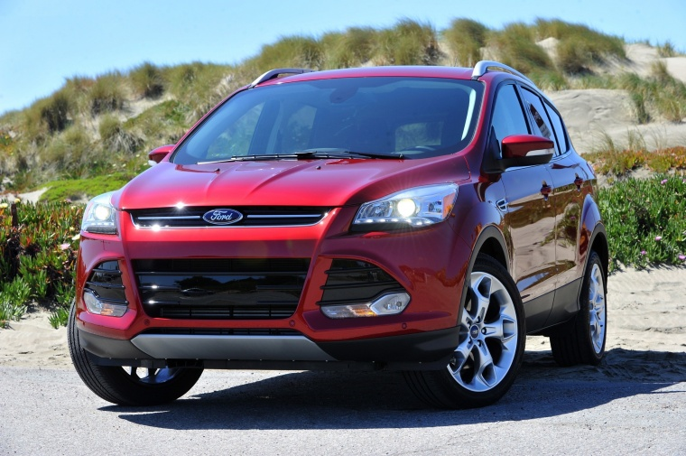 Picture of a 2015 Ford Escape Titanium 4WD in Ruby Red Tinted Clearcoat from a front left perspective