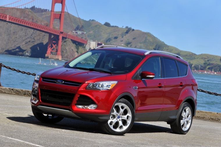 2015 Ford Escape Titanium 4WD in Ruby Red Tinted Clearcoat from a front left three-