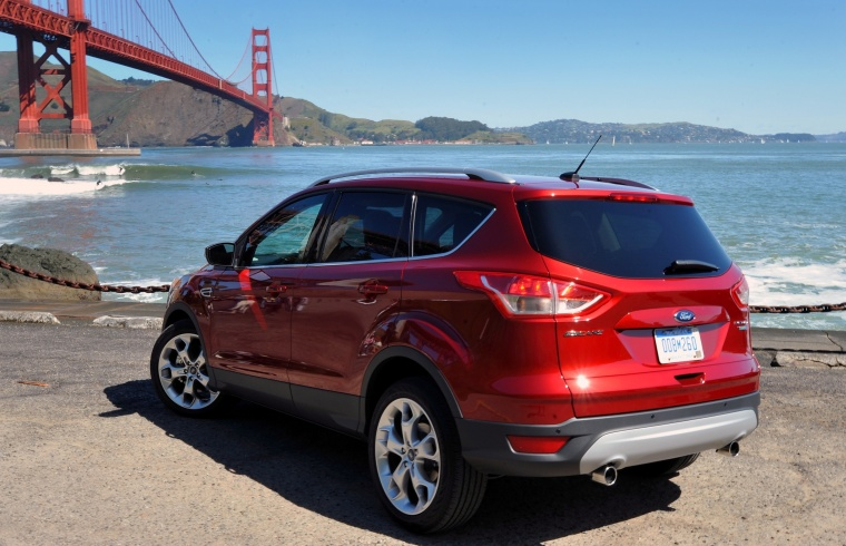 2015 Ford Escape Titanium 4WD in Ruby Red Tinted Clearcoat from a rear left three-