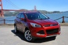 Picture of a 2015 Ford Escape Titanium 4WD in Ruby Red Tinted Clearcoat from a front right perspective