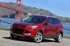 Picture of a 2015 Ford Escape Titanium 4WD in Ruby Red Tinted Clearcoat from a front left three-quarter perspective