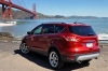 Picture of a 2015 Ford Escape Titanium 4WD in Ruby Red Tinted Clearcoat from a rear left three-quarter perspective