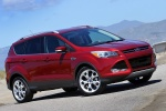 Picture of a 2015 Ford Escape Titanium 4WD in Ruby Red Tinted Clearcoat from a front right three-quarter perspective