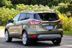 Picture of a driving 2015 Ford Escape Titanium 4WD from a rear left perspective