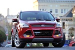Picture of a 2015 Ford Escape Titanium 4WD in Ruby Red Tinted Clearcoat from a frontal perspective