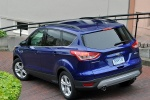 Picture of a 2015 Ford Escape SE in Deep Impact Blue from a rear left three-quarter perspective