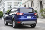 Picture of a 2015 Ford Escape SE in Deep Impact Blue from a rear left perspective