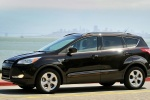 Picture of a driving 2015 Ford Escape in Tuxedo Black from a side perspective