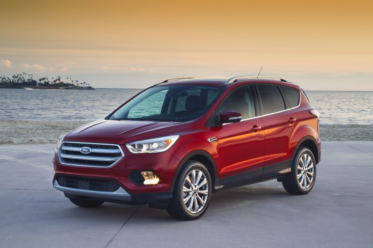 Picture of a 2017 Ford Escape Titanium in Ruby Red Metallic Tinted Clearcoat from a front left three-quarter perspective