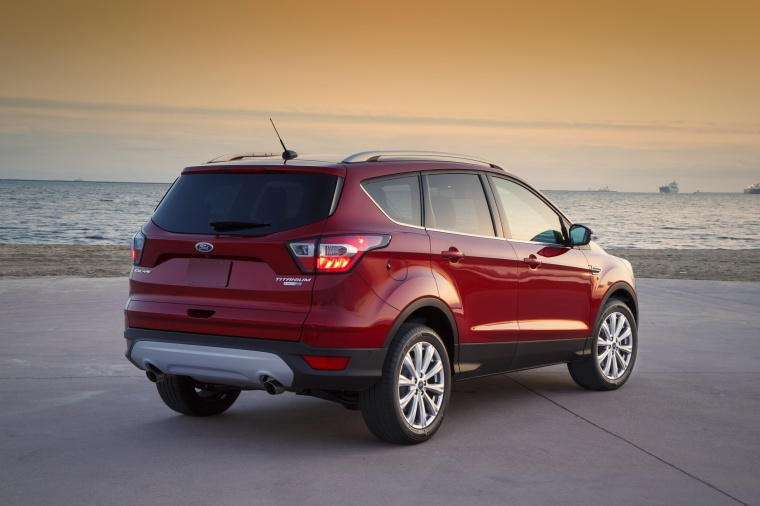 2017 Ford Escape Titanium in Ruby Red Metallic Tinted Clearcoat from a rear right three-quarter view