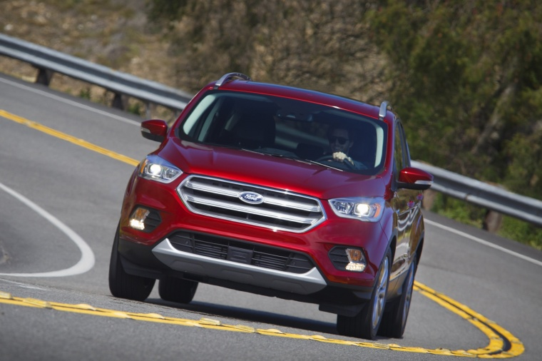 Driving 2017 Ford Escape Titanium in Ruby Red Metallic Tinted Clearcoat from a frontal view