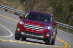 Picture of a driving 2017 Ford Escape Titanium in Ruby Red Metallic Tinted Clearcoat from a frontal perspective
