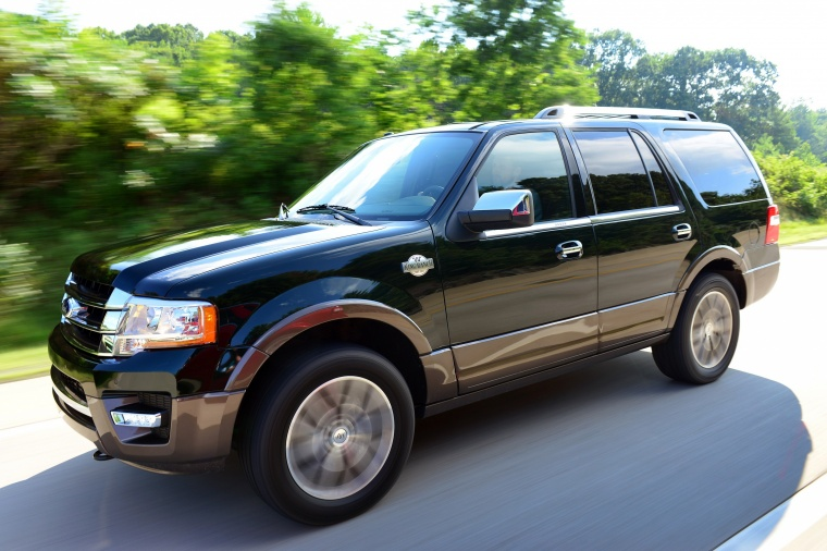 Driving 2016 Ford Expedition King Ranch in Green Gem Metallic from a front left view