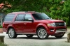 2016 Ford Expedition Platinum in Ruby Red Metallic Tinted Clearcoat from a front right three-quarter view