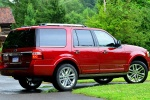 Picture of a 2016 Ford Expedition Platinum in Ruby Red Metallic Tinted Clearcoat from a rear right three-quarter perspective