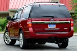 Picture of a 2016 Ford Expedition Platinum in Ruby Red Metallic Tinted Clearcoat from a rear left perspective