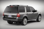 Picture of a 2016 Ford Expedition Platinum in Magnetic Metallic from a rear right three-quarter perspective
