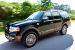 Picture of a driving 2016 Ford Expedition King Ranch in Green Gem Metallic from a front left perspective