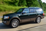 Picture of a driving 2016 Ford Expedition King Ranch in Green Gem Metallic from a front left three-quarter perspective