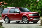 Picture of a 2017 Ford Expedition Platinum in Ruby Red Metallic Tinted Clearcoat from a front right three-quarter perspective