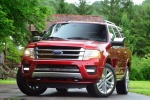 Picture of a 2017 Ford Expedition Platinum in Ruby Red Metallic Tinted Clearcoat from a front left perspective