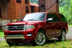 Picture of a 2017 Ford Expedition Platinum in Ruby Red Metallic Tinted Clearcoat from a front left three-quarter perspective