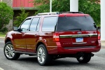 Picture of a 2017 Ford Expedition Platinum in Ruby Red Metallic Tinted Clearcoat from a rear left three-quarter perspective