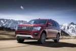 Picture of a driving 2019 Ford Expedition XLT FX4 in Ruby Red Metallic Tinted Clearcoat from a front left three-quarter perspective
