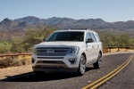 Picture of a driving 2020 Ford Expedition King Ranch in Star White Metallic Tri-Coat from a front left perspective