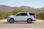 Picture of a driving 2020 Ford Expedition King Ranch in Star White Metallic Tri-Coat from a left side perspective