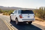 Picture of a driving 2020 Ford Expedition King Ranch in Star White Metallic Tri-Coat from a rear left perspective