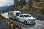 Picture of a driving 2020 Ford Expedition Max Platinum in Oxford White from a front right three-quarter perspective