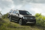 Picture of a driving 2020 Ford Expedition Max Limited in Magnetic Metallic from a front right three-quarter perspective