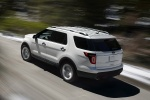 2013 Ford Explorer Limited 4WD in White Suede - Driving Rear Left Three-quarter View