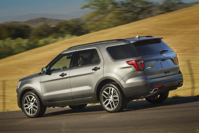 Driving 2016 Ford Explorer Sport 4wd In Magnetic Metallic From A Rear Left Three Quarter