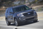 Picture of a driving 2016 Ford Explorer Sport 4WD in Magnetic Metallic from a front right perspective