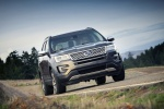 Picture of a driving 2016 Ford Explorer Platinum 4WD in Magnetic Metallic from a front right perspective