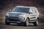 Picture of a driving 2016 Ford Explorer Platinum 4WD in Magnetic Metallic from a front left perspective