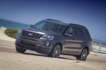 Picture of a driving 2017 Ford Explorer Sport 4WD in Magnetic Metallic from a front left three-quarter perspective