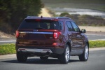Picture of a driving 2017 Ford Explorer Limited 4WD from a rear right perspective