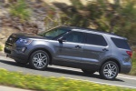 Picture of a driving 2019 Ford Explorer Sport 4WD in Magnetic Metallic from a side perspective