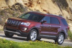 Picture of a driving 2019 Ford Explorer Limited 4WD from a front left perspective