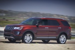 Picture of a driving 2019 Ford Explorer Limited 4WD from a front left three-quarter perspective