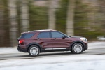 Picture of a driving 2020 Ford Explorer Platinum V6 EcoBoost 4WD in Rich Copper Metallic Tinted Clearcoat from a right side perspective