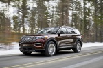 Picture of a driving 2020 Ford Explorer Platinum V6 EcoBoost 4WD in Rich Copper Metallic Tinted Clearcoat from a front left three-quarter perspective